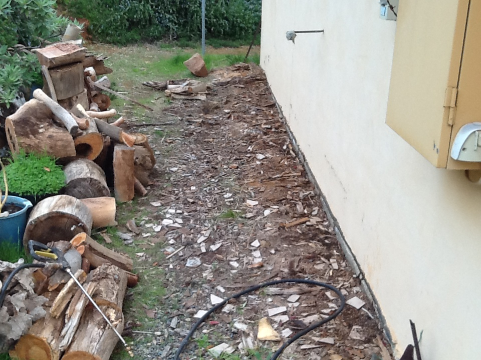 Termites Gaining Access Behind Woodpile Outback Pest Control